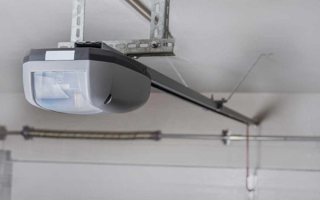 Electric garage door opener installed in garage